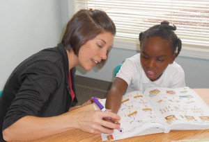 The MDE School's Lindsey Valenly works closely with a student. PHOTO / MDE School