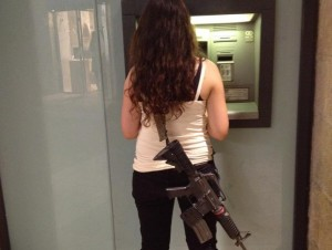 This young woman carts around her IDF weapon as she runs errands in Jerusalem. PHOTO / Malka Riesenberg