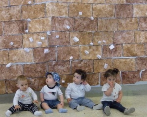 The very youngest students at GHA celebrate Yom Ha'atzmaut, too! Posing at the Early Childhood Department's rendition of Jerusalem's Western Wall, left to right: Yakir Stern, Lev Geller, Charles Tobin, and Leah Lefkove. PHOTO / GHA
