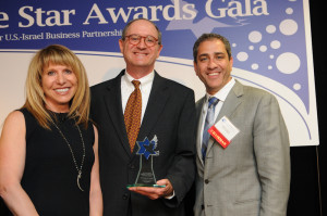 AICC President Tom Glaser (center), recipient of the Chamber Founders Award, with emcee Barbara Kaufman (left) and AICC Chairman Lorin Coles (right).