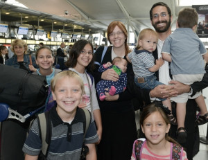 The Pelta family gathers together at New York's JFK Airport shortly before making Aliyah to Israel with Nefesh B'Nefesh. PHOTO / Shahar Azran