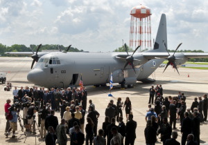 Israel and Marietta Martin officials with C-130J Super Hercules airlifter.