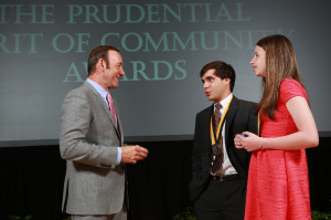 Academy Award-winning actor Kevin Spacey congratulates David Resnick (center) and Kelsey Hirsch.