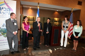 Israeli Consul General Opher Aviran (with microphone) had only kind words for Sharon Kabalo (at his right), who will be returning to Israel after five years in Atlanta. PHOTO / Israeli Consul General's Office