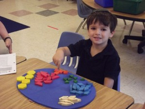 Micah Kraitzick, a student in GHA's Running Start Kindergarten, has a little fun with a math lesson.