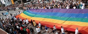 Annual Gay Pride parade attracts thousands to downtown Atlanta.