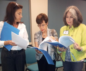 Mira Hirsch (L-R), Judy Cone and Phyllis Cohen look over scripts, all part of a special program presented recently for members of Ketura Hadassah.
