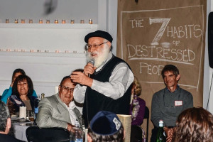 Rabbi Laibl Wolf leads program on dealing with stress at Chabad In-Town.