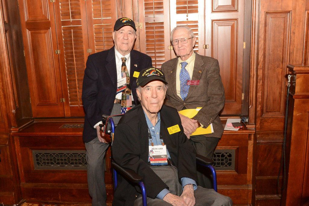 Longtime Atlanta Jewish community members Hilbert (left) and Howard Margol, shown with Rep. John Yates on Jan. 27, were part of the 42nd Infantry Division when it liberated Dachau on April 29, 1945.