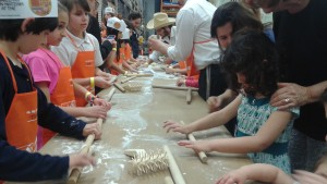 Newly trained matzah makers stick to their task March 26 at the Home Depot on Piedmont Road in Buckhead.