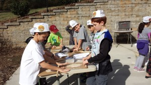 The clock is ticking as Chabad Hebrew School students roll out their matzah dough.
