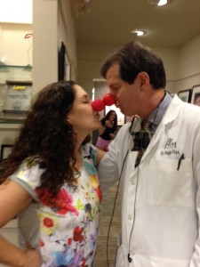 Dr. Hugh Flax and his wife, Robyn, share a nose rub on Red Nose Day on May 21.