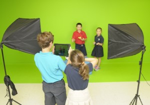 Davis Academy Lower School students shoot video against the green screen in the Idea Lab.