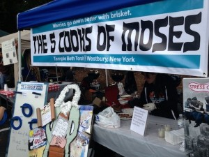 Teams at the Kosher BBQ contest compete in everything from brisket to booth design and team name