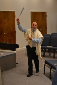Rabbi Lou Feldstein has some fun during Simchat Torah.