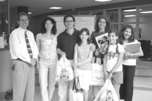 In September 2005, Head of School Stan Beiner (left) helps welcome Katrina families Susan Levitas and Jake Schwartz and daughter Cydney and Laura Fuhrman and daughters Allison and Melissa to the Epstein School.