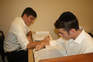 Seniors Naftali Mamane (left) and Yosef Levi Grossblatt study in the beis midrash.