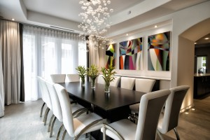"The white dining room showcases Henrik Abedian's ""Henrik,"" a triptych in mixed-media acrylic."