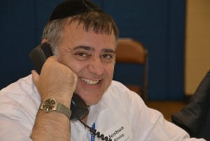 Rabbi Joshua Einzig, the head of school at Torah Day School, chips in with phone calls during Federation's Super Sunday.