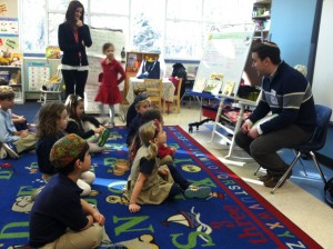 SOJOURN Executive Director Rebecca Stapel-Wax and Assistant Director Robbie Medwed read to Epstein School kindergartners.