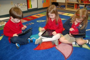 Mechina pupils engage in independent learning activities using tablet technology.