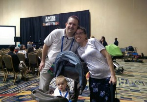 Rabbi Erin Boxt of Temple Kol Emeth schmoozes near the Jewish Rock Radio Stage with wife Batya and their younger daughter, Danika.