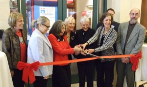 With a slight struggle, centennial chair Phyllis Cohen (from left), Greater Atlanta Hadassah President Paula Zucker, National President Marcie Natan and exhibition chair Ruthanne Warnick cut the ribbon on Hadassah Atlanta's centennial exhibit at the Breman Museum on Nov. 1. Joining the quartet in the middle are Southeastern Region President Toby Parker (left), Israeli Consul General Judith Varnai Shorer, Breman Executive Director Aaron Berger and exhibition display designer Dale Brubaker.