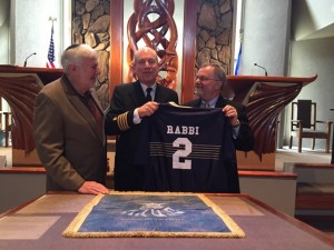 After Shabbat, Rabbi Albert Slomovitz shows off his Navy football jersey between Rabbi Shalom Lewis and 1972 Naval Academy graduate Stephen Dix.