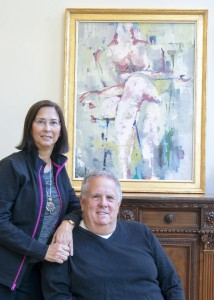"Melanie and Gary Bodner pose in front of his ""A Nude."""