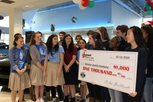 Atlanta Jewish Academy students (back row from left) Jesse Cann, Gil Vayner, Avi Greene, Dauren Parker, Rachel Kahen, Shira Solomon, Nicole Nooriel and Ellie Parker and (front row from left) Oryah Bunder, Ruby Jacobs and Maia Dori attend the announcement of the winning high school in Landmark's Atlanta Teen Safe Driving contest Friday, Dec. 11.