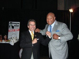 Michael Coles has some fun with George Foreman during a speech he gave in Minneapolis to over 10,000 people. Others on the bill that day included Donald Trump.