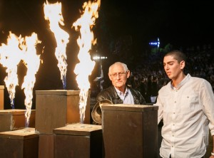 Ari Livne and grandson Tomer light the beacon at the Yom HaShoah ceremony in 2013 at Makhon Massuah in Israel.