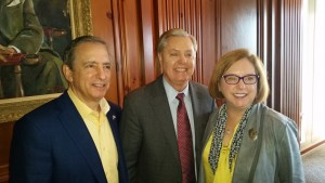 Local Republican Jewish Coalition leaders Chuck and Bonnie Berk welcome Sen. Lindsey Graham.
