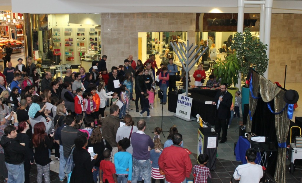 Chabad of North Fulton took its Chanukah celebrations to North Point Mall as well as its own campus on the Alpharetta-Johns Creek line. Rabbi Hirshy Minkowicz draws a crowd at North Point Mall with a giant Chabad chanukiah on the first night of Chanukah.