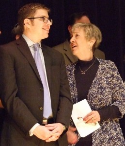 """Sherry Frank, the former longtime leader of the American Jewish Committee's Atlanta Chapter, stands with the office's current assistant director, Harold Hershberg, after her impassioned speech against """"the demagogues and bigots."""""""