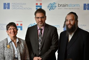 Atlantan Rachel Schonberger, who chairs the Hadassah Medical Organization, stands with HMO neurologist Dimitrios Karussis and BrainStorm CEO Chaim Lebovits.