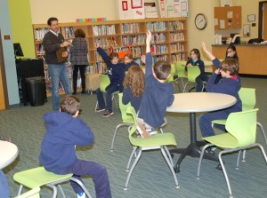 A Google representative gets user feedback from Davis Lower School pupils.