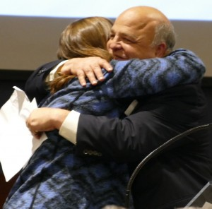 Camp Coleman Director Bobby Harris gives Lauren Gordon a big hug to go with her Power of One award.