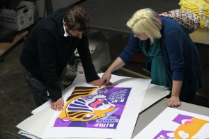 Katie Welch (right) finalizes the poster design before printing.