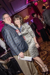 Mark Kopkin, in a custom-made sports jacket, poses with Tami Wecksler in David Meister from Neiman Marcus. Charles David shoes complete her look.