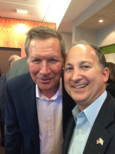 Dan Israel (right) with John Kasich