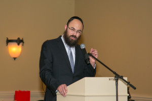 Rabbi Ephraim Silverman, the head of Chabad of Cobb, makes a point during the ceremony.