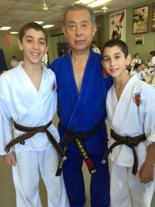 Matan and Ori Gal pose with Mits Uchida of the U.S. Taido Karate School.