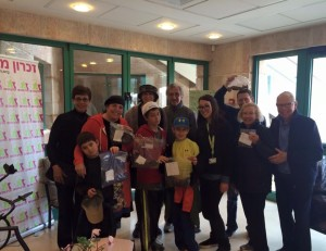 The Wilson family arrives at Zichron Menachem with six bags of donated hair in February.