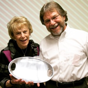 Sally Kaplan receives a gift of appreciation from food bank head Bill Bolling.