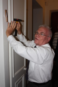 A mezuzah goes up at the new Beit Centrum Ki Tov in central Warsaw.