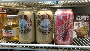The Fridge at Sunny's carries an interesting variety of drinks including a Dr. Brown's Cream Soda sitting next to a Colombian Postobón Apple drink