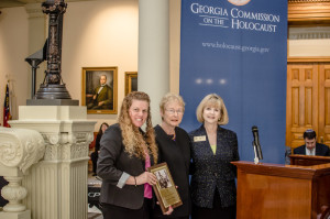 Am Yisrael Chai President Andrea Videlefsky (left) accepts the Humanitarian Award from the Commission on the Holocaust's chairwoman, Claire D'Agostino, and executive director, Sally Levine.
