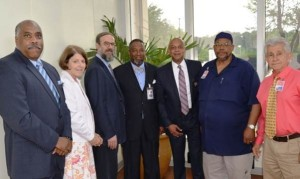 Among the honored chaplains surrounding Sheriff Jeff Mann (third from right) are (from left) William Churchill, Patricia Bloch, Rabbi Hillel Norry, Curtis Crocker Jr., Furqan Muhammad and Ephraim Espinosa.