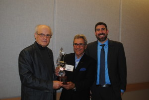 Ken Stein accepts the Opher Aviran Award from Hillels of Georgia President Michael Coles (center) and Executive Director Russ Shulkes.